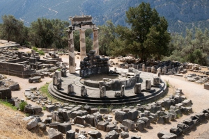 Ancient greek ruins of Delphi with wooded landscape